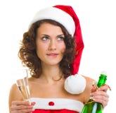Mulher na roupa de Papai Noel com frasco do champanhe Imagem de Stock Royalty Free