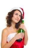 Mulher na roupa de Papai Noel com frasco do champanhe Fotos de Stock
