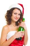 Mulher na roupa de Papai Noel com frasco do champanhe Imagens de Stock