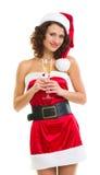 Mulher na roupa de Papai Noel com vidro do champanhe Fotos de Stock Royalty Free