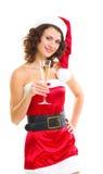 Mulher na roupa de Papai Noel com vidro do champanhe Imagem de Stock Royalty Free