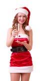 Mulher na roupa de Papai Noel com vidro do champanhe Fotografia de Stock