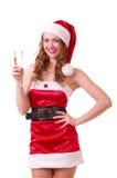 Mulher na roupa de Papai Noel com vidro do champanhe Fotografia de Stock Royalty Free