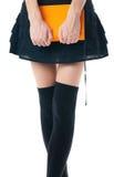 Mulher na saia e nas meias fotografia de stock royalty free