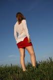 Mulher na saia vermelha Fotos de Stock