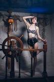 Mulher na sala de sal em um maiô Fotos de Stock Royalty Free