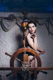 Mulher na sala de sal em um maiô Fotografia de Stock