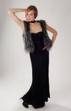 Mulher na veste do vestido e da pele Fotografia de Stock Royalty Free