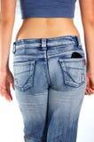 Mulher nas calças de brim Fotografia de Stock Royalty Free