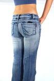 Mulher nas calças de brim Imagem de Stock Royalty Free