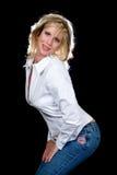 Mulher nas calças de brim fotografia de stock
