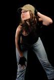 A mulher nas calças de brim e em um tampão à moda Imagem de Stock Royalty Free