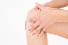 Mulher natural que toca em seu joelho doloroso Foto de Stock Royalty Free