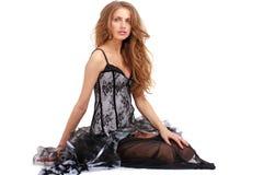 Mulher no assento do vestido Foto de Stock