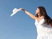 Mulher no céu com chapéu Imagem de Stock