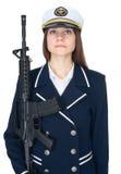 Mulher no capitão de mar uniforme com rifle Fotografia de Stock