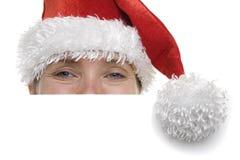 Mulher no chapéu de Santa com sinal Fotos de Stock Royalty Free