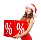 Mulher no chapéu do ajudante de Santa com sinal de por cento Imagem de Stock Royalty Free
