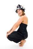Mulher no chapéu do divertimento do ventilador foto de stock