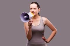 A mulher no conceito dos esportes com altifalante Fotografia de Stock Royalty Free