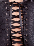 Mulher no espartilho preto Imagens de Stock