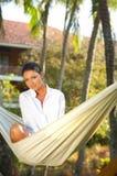 Mulher no hammock Fotos de Stock Royalty Free