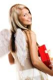 Mulher no Natal com um presente Fotos de Stock Royalty Free