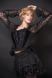 Mulher no preto Imagem de Stock Royalty Free