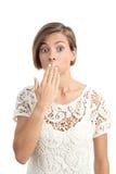 Mulher no problema que gesticula oops com uma mão na boca Imagem de Stock Royalty Free