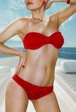 Mulher no roupa interior vermelho no iate Fotos de Stock Royalty Free