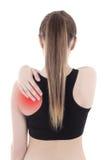 A mulher no sportswear com dor nela isolou-se para trás no branco fotografia de stock