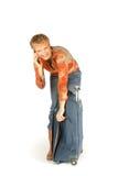 Mulher no telefone com mala de viagem Imagens de Stock