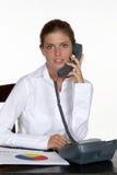 Mulher no telefone que olha a câmera Fotos de Stock