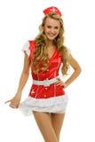 Mulher no traje do carnaval. Forma da enfermeira Imagens de Stock