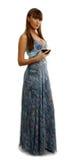 Mulher no vestido bonito que come um vidro do vinho Imagem de Stock