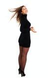 Mulher no vestido e em meias pretos fotografia de stock royalty free