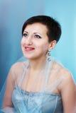 Mulher no vestido no fundo azul Imagem de Stock Royalty Free