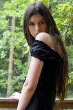 Mulher no vestido preto Imagem de Stock Royalty Free