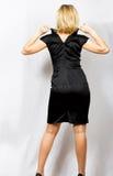 Mulher no vestido preto Foto de Stock Royalty Free