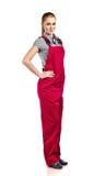 Mulher nos macacões vermelhos, isolados no branco Fotos de Stock Royalty Free