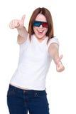 Mulher nos vidros 3d que mostram os polegares acima Fotografia de Stock