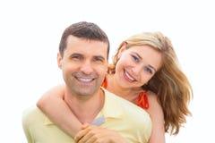 A mulher nova abraça o homem atrás Fotos de Stock Royalty Free