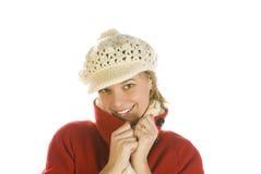 Mulher nova adorável em um tampão do inverno Imagem de Stock Royalty Free
