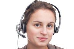 Mulher nova amigável com auriculares Fotografia de Stock Royalty Free