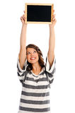 Mulher nova atrativa com sinal em branco fotografia de stock royalty free