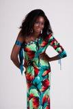 Mulher nova atrativa em um vestido colorido Foto de Stock Royalty Free