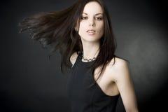 Mulher nova bonita com cabelo do vôo Foto de Stock Royalty Free