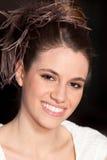 Mulher nova bonita com grande sorriso do penteado fotografia de stock