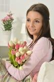 Mulher nova bonita com tulips Imagem de Stock