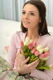 Mulher nova bonita com tulips Fotos de Stock